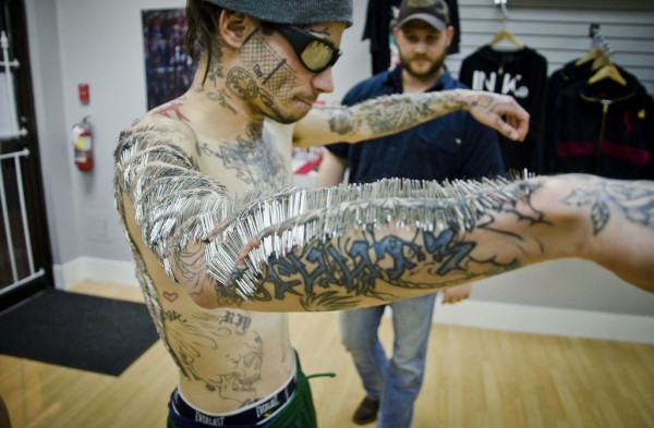 ** MANDATORY BYLINE ** - PIC FROM D.E MEDIA / CATERS NEWS - (PICTURED: Matthew Menczyk pierced) - A tattoo fanatic has broken the world record for most piercings in one sitting, enduring more than a whopping 4500 in EIGHT HOURS. Matthew Menczyk had 4550 surgical needles pierce skin on his arms and up his back  breaking the previous record by an impressive 650. Looking like a layer of armour has been woven into his skin, Matthew, 30, fought through the blood and pain to smash the old record for Most Surgical Needle Piercings in One Session (8 hours timeframe). Body modification specialist Russ Foxx carried out the record smashing session in Vancouver, Canada. SEE CATERS COPY.